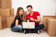 Couple buying furniture online Stock Images