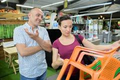 Couple buying furniture at retail store Royalty Free Stock Image
