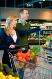 Couple Buying Groceries Royalty Free Stock Image