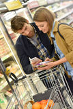 Couple buying groceries in supermarket Stock Image