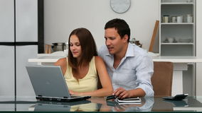 Couple buying on internet with a credit card Royalty Free Stock Photography