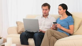 Couple buying on the internet stock video footage