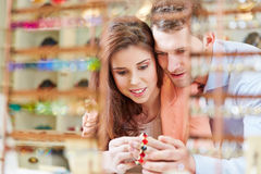 Couple buying juwelry in store Stock Image