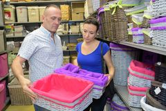 Couple buying laundry basket Stock Photos