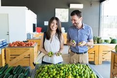 Couple Buying Lemons Together In Store stock image