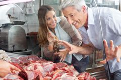 Couple Buying Meat At Butcher's Shop Royalty Free Stock Photography