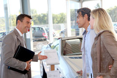 Couple buying new car stock images