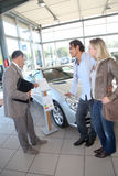 Couple buying new car Royalty Free Stock Photo