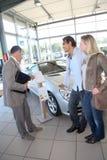 Couple buying new car Royalty Free Stock Photo