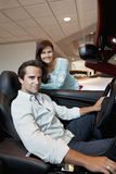 Couple buying a new car Royalty Free Stock Photography