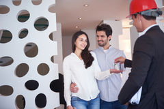 Couple buying new home with real estate agent Stock Photo