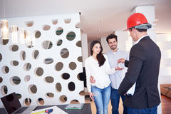Couple buying new home with real estate agent Royalty Free Stock Photo