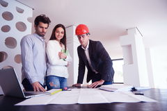 Couple buying new home with real estate agent Royalty Free Stock Photos