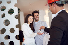 Couple buying new home with real estate agent Stock Photography