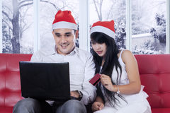 Couple buying online in christmas day Stock Photo