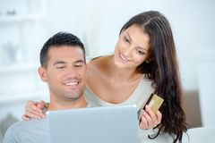Couple buying online on internt with credit card Stock Photo