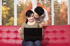 Couple buying online with laptop Stock Photography