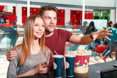 Couple buying popcorn and coke Stock Images
