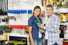 Couple Buying Product In Hardware Store Stock Images