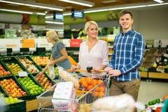 Couple buying sweet fruits Stock Photo