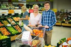 Couple buying sweet fruits Royalty Free Stock Images
