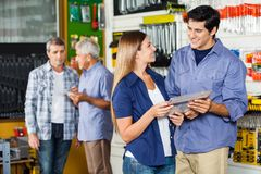 Couple Buying Tool Set In Hardware Store Stock Photo