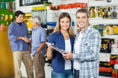 Couple Buying Tool Set In Hardware Store Royalty Free Stock Photos