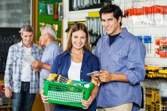Couple Buying Tools At Hardware Store Stock Image