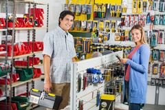 Couple Buying Tools In Hardware Store Stock Photos