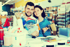 Couple buying tools for house decoration Royalty Free Stock Photos