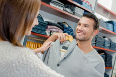Couple buying trendy new clothes Stock Images