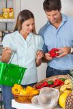Couple Buying Vegetables In Grocery Store Stock Image
