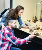 Couple buying watches during eurotrip. Happy couple of tourists buying swiss watches during their trip around Europe Royalty Free Stock Photography