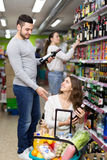 Couple buying wine and beer Royalty Free Stock Photo