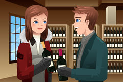 Couple buying wine Stock Photo