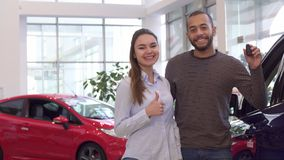 Couple buys car at the dealership royalty free stock image