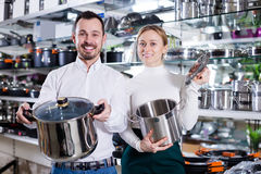 Couple buys saucepans Royalty Free Stock Photo
