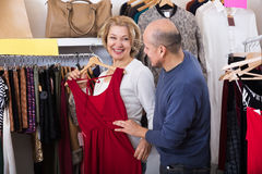 Couple buys some dresses Royalty Free Stock Image