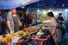 Couple buys traditional Thai street food Royalty Free Stock Image