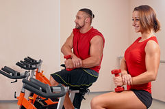 Couple bycicle cycling in gym Royalty Free Stock Photo