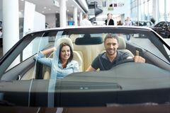 Couple in a cabriolet Royalty Free Stock Photo