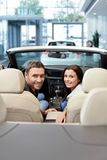 Couple in a cabriolet Royalty Free Stock Image