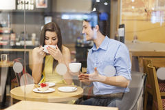 Couple at cafe. Happy couple talking in cafe Stock Image