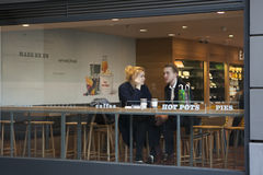 Couple in a cafe in London. Royalty Free Stock Photo