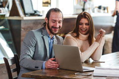 Couple in a cafe looking to laptop Royalty Free Stock Images