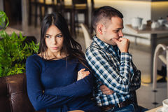 Couple at cafe during lunch. They are taking offense and sitting back royalty free stock photography