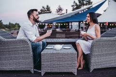Couple in cafe outdoors royalty free stock image