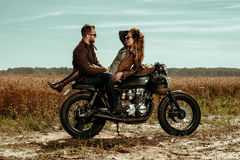 Couple and cafe racer motorcycle Stock Photo