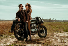 Couple and cafe racer motorcycle Stock Image