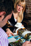 Couple in cafe rading Stock Photo